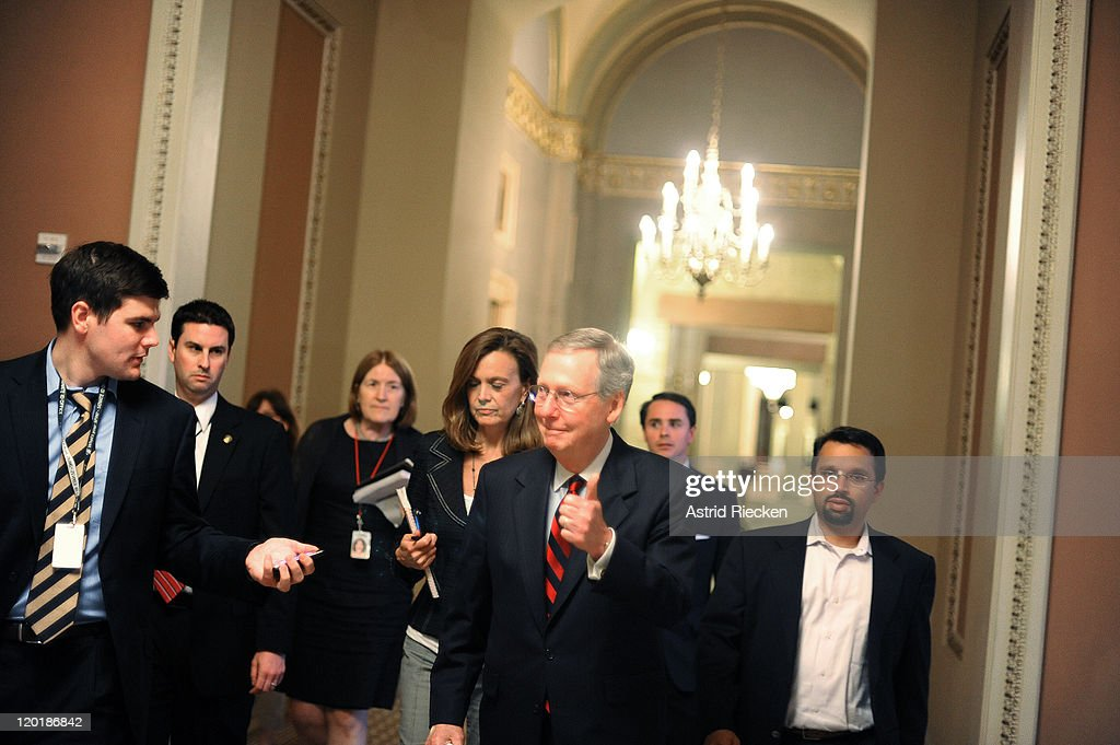 U.S. Senate Minority Leader Sen. <a gi-track='captionPersonalityLinkClicked' href=/galleries/search?phrase=Mitch+McConnell&family=editorial&specificpeople=217985 ng-click='$event.stopPropagation()'>Mitch McConnell</a> (R-KY) gives a thumbs up when asked whether a deal has been reached regarding the ongoing debate on the national debt reduction on July 31, 2011 in Washington, DC. As the United States approaches the possibility of a default, the congressional leaders and the White House try to reach an agreement on measures to lift the debt ceiling.