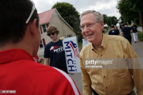 Senate Minority Leader Sen Mitch McConnell greets supporters at the Adairville Strawberry Festival parade while campaigning for the Republican...