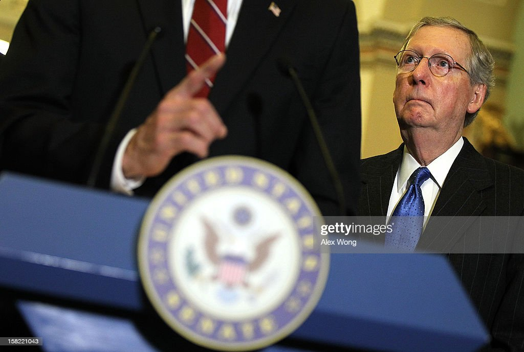 U.S. Senate Minority Leader Sen. <a gi-track='captionPersonalityLinkClicked' href=/galleries/search?phrase=Mitch+McConnell&family=editorial&specificpeople=217985 ng-click='$event.stopPropagation()'>Mitch McConnell</a> (R-KY) listens during a news briefing after the weekly Senate Republican Policy Luncheon December 11, 2012 on Capitol Hill in Washington, DC. McConnell discussed various topics with the media including the fiscal cliff issue saying 'time is running out.'