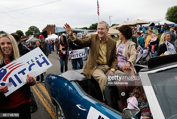 Senate Minority Leader Sen Mitch McConnell rides in the Fountain Run BBQ Festival parade with his wife Elaine Chao while campaigning for the...