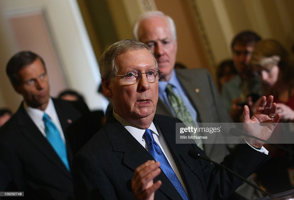 Senate Minority Leader Sen. Mitch McConnell (R-KY) (C) speaks after the Senate voted on the debt limit bill as Sen. John Cornyn (R-TX) (R) and Sen. John Thune (R-SD) look on at the U.S. Capitol on August 2, 2011 in Washington, DC. The Senate voted 74-26 to approve the bill to raise the debt ceiling, allowing the U.S. to avoid default on its debts.