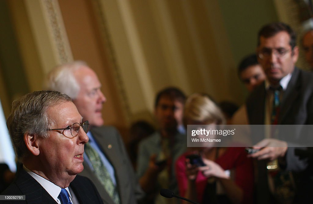 Senate Minority Leader Sen. Mitch McConnell (R-KY) (L) speaks after the Senate voted on the debt limit bill as Sen. John Cornyn (R-TX) (2nd L) looks on at the U.S. Capitol on August 2, 2011 in Washington, DC. The Senate voted 74-26 to approve the bill to raise the debt ceiling, allowing the U.S. to avoid default on its debts.