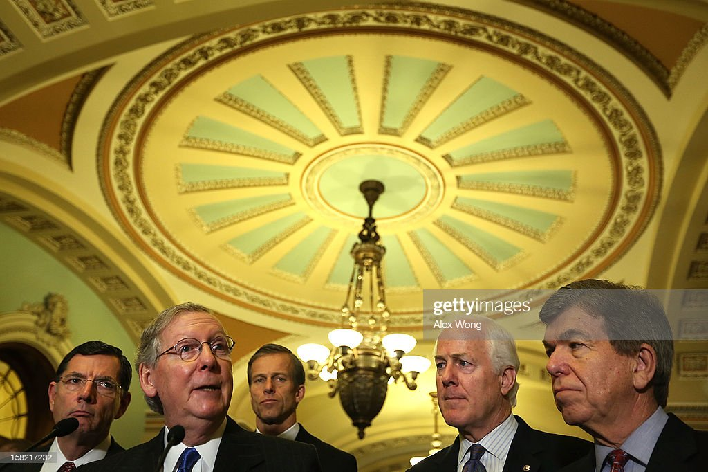 U.S. Senate Minority Leader Sen. <a gi-track='captionPersonalityLinkClicked' href=/galleries/search?phrase=Mitch+McConnell&family=editorial&specificpeople=217985 ng-click='$event.stopPropagation()'>Mitch McConnell</a> (R-KY) (2n L) speaks as (L-R) Sen. John Barrasso (R-WY), Sen. <a gi-track='captionPersonalityLinkClicked' href=/galleries/search?phrase=John+Thune&family=editorial&specificpeople=534356 ng-click='$event.stopPropagation()'>John Thune</a> (R-SC), Sen. <a gi-track='captionPersonalityLinkClicked' href=/galleries/search?phrase=John+Cornyn&family=editorial&specificpeople=154884 ng-click='$event.stopPropagation()'>John Cornyn</a> (R-TX) and Sen. <a gi-track='captionPersonalityLinkClicked' href=/galleries/search?phrase=Roy+Blunt&family=editorial&specificpeople=233679 ng-click='$event.stopPropagation()'>Roy Blunt</a> (R-MO) listen during a news briefing after the weekly Senate Republican Policy Luncheon December 11, 2012 on Capitol Hill in Washington, DC. McConnell discussed various topics with the media including the fiscal cliff issue saying 'time is running out.'