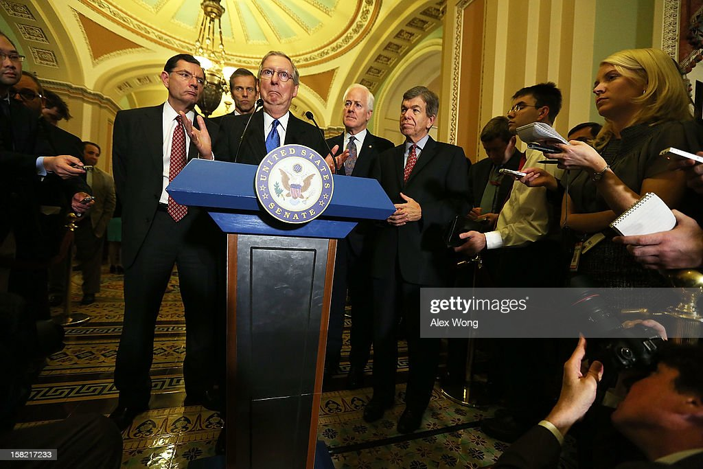 U.S. Senate Minority Leader Sen. Mitch McConnell (R-KY) speaks as (L-R) Sen. John Barrasso (R-WY), Sen. John Thune (R-SC), Sen. John Cornyn (R-TX) and Sen. Roy Blunt (R-MO) listen during a news briefing after the weekly Senate Republican Policy Luncheon December 11, 2012 on Capitol Hill in Washington, DC. McConnell discussed various topics with the media including the fiscal cliff issue saying 'time is running out.'