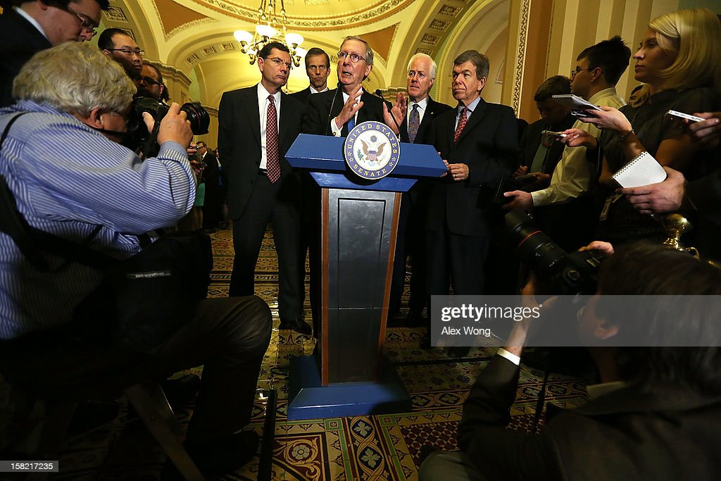 U.S. Senate Minority Leader Sen. Mitch McConnell (R-KY) speaks as (L-R) Sen. John Barrasso (R-WY), Sen. <a gi-track='captionPersonalityLinkClicked' href=/galleries/search?phrase=John+Thune&family=editorial&specificpeople=534356 ng-click='$event.stopPropagation()'>John Thune</a> (R-SC), Sen. <a gi-track='captionPersonalityLinkClicked' href=/galleries/search?phrase=John+Cornyn&family=editorial&specificpeople=154884 ng-click='$event.stopPropagation()'>John Cornyn</a> (R-TX) and Sen. <a gi-track='captionPersonalityLinkClicked' href=/galleries/search?phrase=Roy+Blunt&family=editorial&specificpeople=233679 ng-click='$event.stopPropagation()'>Roy Blunt</a> (R-MO) listen during a news briefing after the weekly Senate Republican Policy Luncheon December 11, 2012 on Capitol Hill in Washington, DC. McConnell discussed various topics with the media including the fiscal cliff issue saying 'time is running out.'