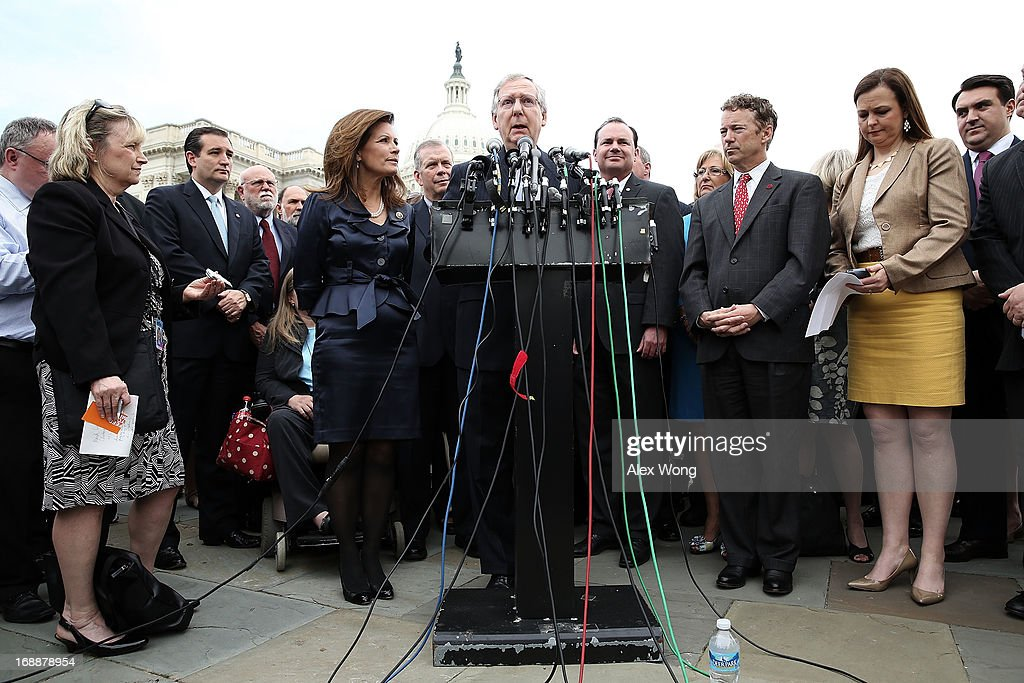 S Senate Minority Leader Sen Mitch McConnell speaks as Sen Ted Cruz Rep Michele Bachmann Sen Mike Lee Sen Rand Paul and cofounder and CEO of Tea...
