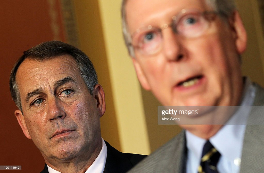 U.S. Senate Minority Leader Sen. <a gi-track='captionPersonalityLinkClicked' href=/galleries/search?phrase=Mitch+McConnell&family=editorial&specificpeople=217985 ng-click='$event.stopPropagation()'>Mitch McConnell</a> (R-KY) (R) speaks as Speaker of the House Rep. <a gi-track='captionPersonalityLinkClicked' href=/galleries/search?phrase=John+Boehner&family=editorial&specificpeople=274752 ng-click='$event.stopPropagation()'>John Boehner</a> (R-OH) (L) looks on during a news conference on the debt ceiling negotiation July 30, 2011 on Capitol Hill in Washington, DC. McConnell told the press at the news conference that he had talked to President Barack Obama and he's confident that an agreement can be reached very soon. The House rejected U.S. Senate Majority Leader Sen. Harry Reid's (D-NV) proposed debt ceiling bill one day after the Senate rejected Boehner's plan.