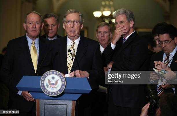 S Senate Minority Leader Sen Mitch McConnell speaks to members of the media as Sen Lamar Alexander Sen Richard Burr Sen Johnny Isakson and Sen Tom...