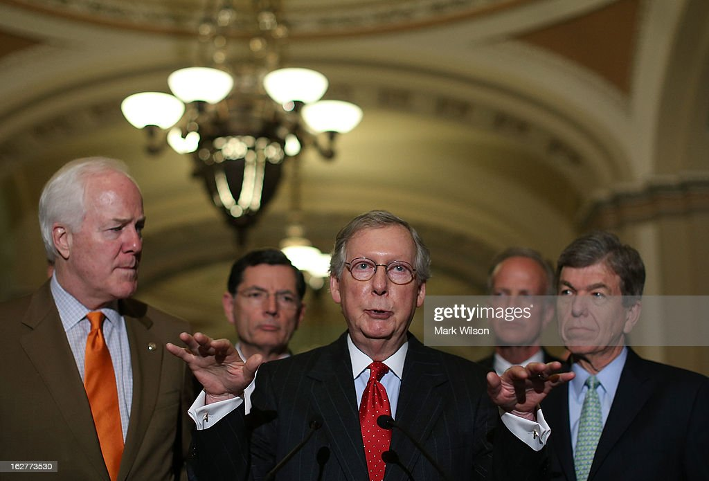 U.S. Senate Minority Leader Sen. <a gi-track='captionPersonalityLinkClicked' href=/galleries/search?phrase=Mitch+McConnell&family=editorial&specificpeople=217985 ng-click='$event.stopPropagation()'>Mitch McConnell</a> (R-KY) (C) speaks to the media as (L-R) Sen. <a gi-track='captionPersonalityLinkClicked' href=/galleries/search?phrase=John+Cornyn&family=editorial&specificpeople=154884 ng-click='$event.stopPropagation()'>John Cornyn</a> (R-TX), Sen. John Barrasso (R-WY), Sen. Jerry Moran (R-KS), and Sen. <a gi-track='captionPersonalityLinkClicked' href=/galleries/search?phrase=Roy+Blunt&family=editorial&specificpeople=233679 ng-click='$event.stopPropagation()'>Roy Blunt</a> (R-MO) listen after their weekly Senate Republican policy luncheon at the U.S. Capitol, February 26, 2013 in Washington, DC. The Republican leadership spoke about the GOP agenda and the possibility of sequestration and its economic impact.