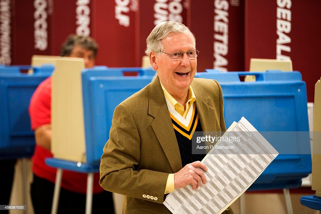 Senate Minority Leader US Sen Mitch McConnell holds his ballot after voting in the midterm elections at Bellarmine University November 4 2014 in...
