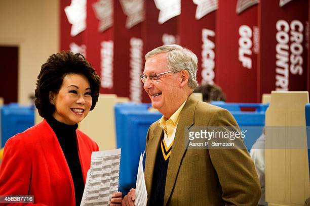 Senate Minority Leader US Sen Mitch McConnell waits after voting in midterm elections with his wife Elaine Chao at Bellarmine University November 4...