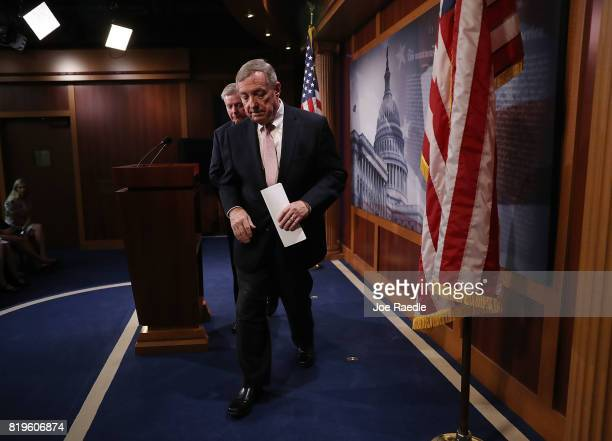 Senate Minority Whip Dick Durbin and Sen Lindsey Graham exit after holding a press conference about the Dream Act of 2017 in the Capitol building on...