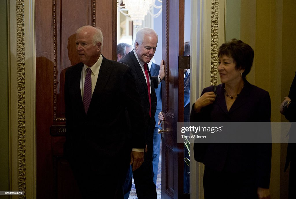 Senate Minority Whip John Cornyn, R-Texas, emerges from his new office on the second floor of the Capitol before the senate luncheons. Sens. Saxby chambliss, R-Ga., and Sue Collins, R-Me., are also pictured.