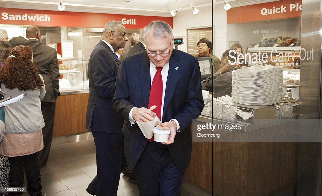 Senate Minority Whip Jon Kyl, a Republican from Arizona, takes an order of soup from the basement Senate Carry Out at the U.S. Capitol in Washington, D.C., U.S., on Monday, Dec. 31, 2012. U.S. lawmakers hurtled toward a midnight deadline to avert hundreds of billions of dollars in tax increases and spending cuts, struggling to extract the country from a fiscal trap they created. Photographer: Jay Mallin/Bloomberg via Getty Images