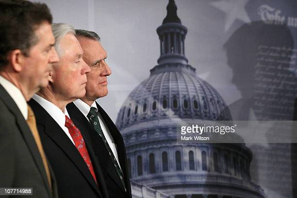 Senate Minority Whip Jon Kyl participates in a news conference with Sen Jim DeMint and Sen Jeff Sessions at the US Capitol on December 21 2010 in...