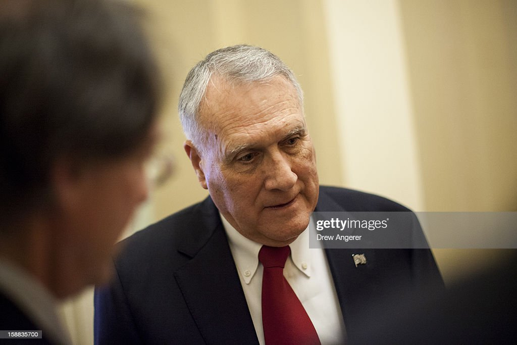 Senate Minority Whip Jon Kyl (R-AZ) speaks with reporters outside of his office on Capitol Hill December 31, 2012 in Washington, DC. The House and Senate are both still in session on New Year's Eve to try to deal with the looming 'fiscal cliff.'