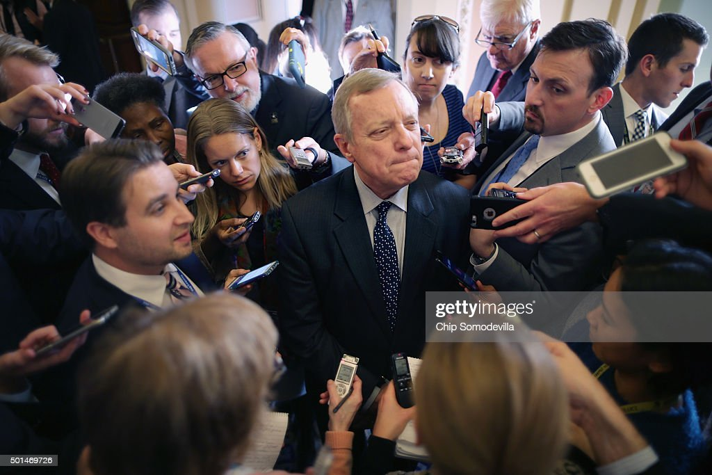 Senate Minority Whip Richard Durbin (D-IL) (C) is surrounded by reporters following the weekly Democratic policy luncheon at the U.S. Capitol December 15, 2015 in Washington, DC. Democratic leaders said they believe the Senate and House of Representatives are close to a deal on an omnibus budget legislation and expect a vote this week.