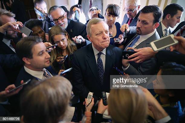 Senate Minority Whip Richard Durbin is surrounded by reporters following the weekly Democratic policy luncheon at the US Capitol December 15 2015 in...