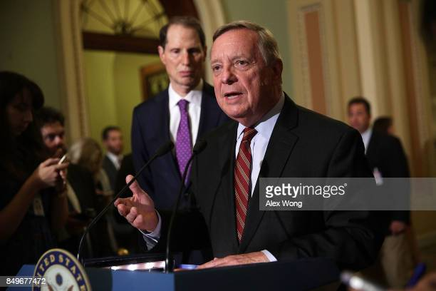 S Senate Minority Whip Sen Dick Durbin speaks as Sen Richard Blumenthal listens during a news briefing after a weekly Senate Democratic policy...
