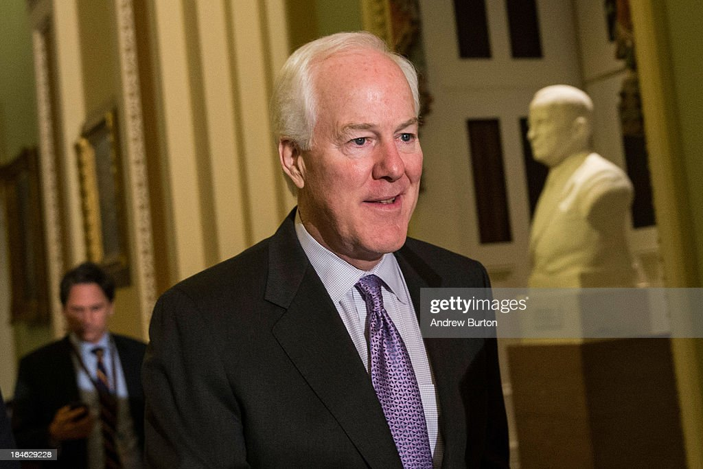 U.S. Senate Minority Whip Sen. <a gi-track='captionPersonalityLinkClicked' href=/galleries/search?phrase=John+Cornyn&family=editorial&specificpeople=154884 ng-click='$event.stopPropagation()'>John Cornyn</a> (R-TX) walks through the Capitol Building on October 14, 2013 in Washington, DC. As Democratic and Republican leaders negotiate an end to the shutdown and a way to raise the debt limit, the White House postponed a planned Monday afternoon meeting with Boehner and other Congressional leaders. The government shutdown is currently in its 14th day.