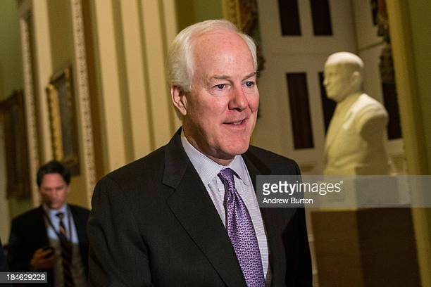 S Senate Minority Whip Sen John Cornyn walks through the Capitol Building on October 14 2013 in Washington DC As Democratic and Republican leaders...