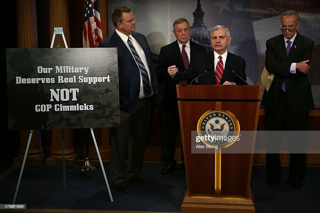 U.S. Senate Minority Whip Sen. Richard Durbin (D-IL) (2nd L), Sen. Jack Reed (D-RI) (3rd L), Sen. Charles Schumer (D-NY) (R) and Sen. Jon Tester (D-MT) (L) participate in a news conference June 4, 2015 on Capitol Hill in Washington, DC. The senators held a news conference to discuss the National Defense Authorization Act.