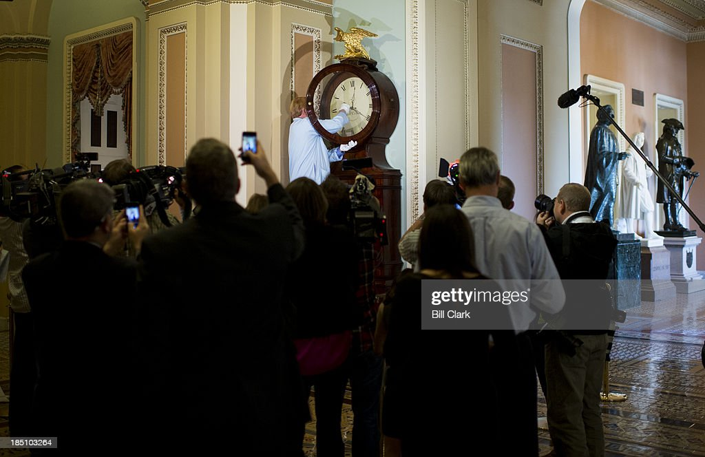S Senate museum specialist Richard Doerner winds the Ohio Clock before a throng of media in the Capitol on Thursday Oct 17 2013 The clock had been...