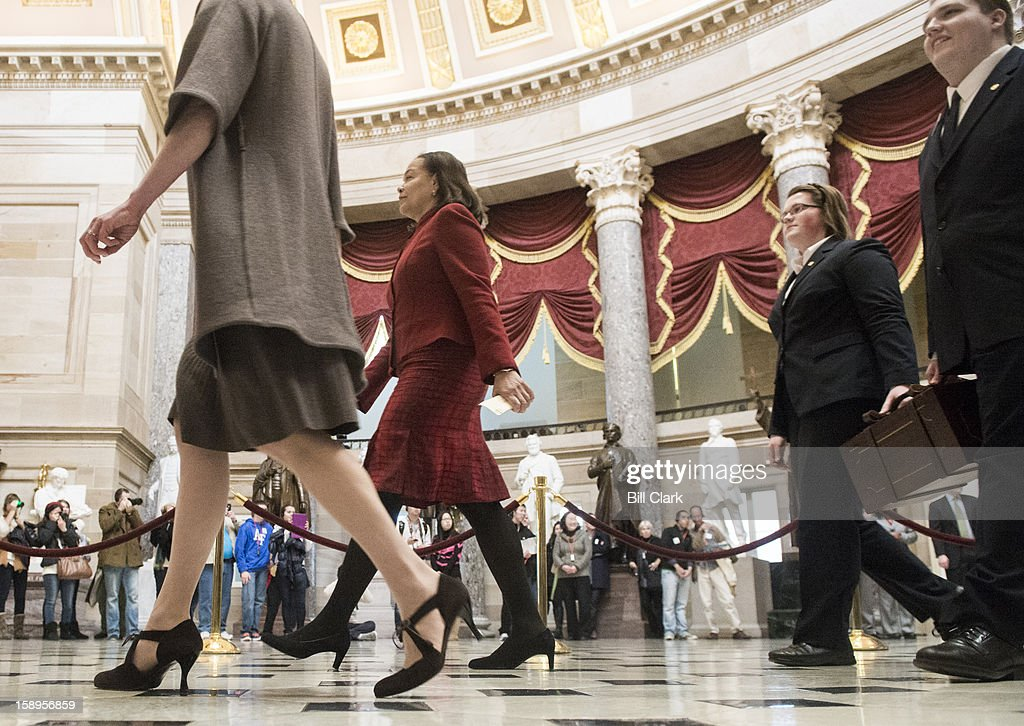 Senate pages carry the presidential electoral ballots through Statuary Hall to the House chamber for the ballot counting on the House floor on Friday, Jan. 4, 2013.
