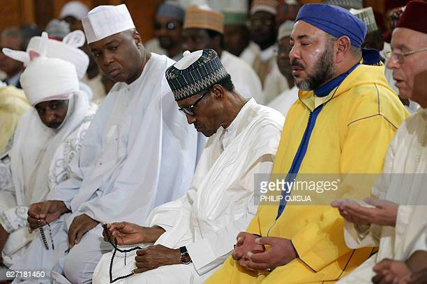 Senate President Bukola Saraki Nigerian President Muhammadu Buhari and King of Morocco Mohammed VI pray at the Nigerian National Mosque in Abuja on...