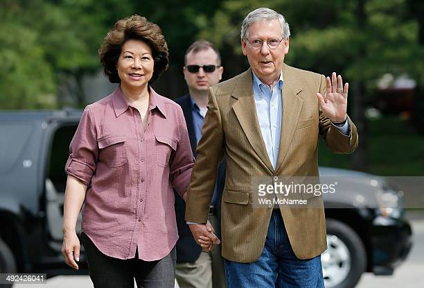 S Senate Republican Leader Sen Mitch McConnell and his wife Elaine Chao arrive at Bellarmine Universiry to vote in the state Republican primary May...