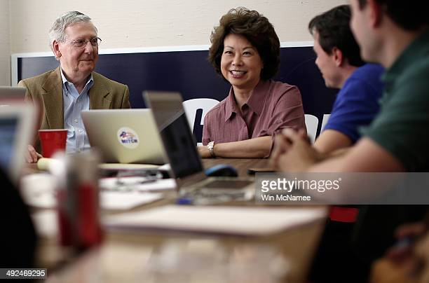 S Senate Republican Leader Sen Mitch McConnell and his wife Elaine Chao meet with members of his staff at campaign headquarters May 20 2014 in...