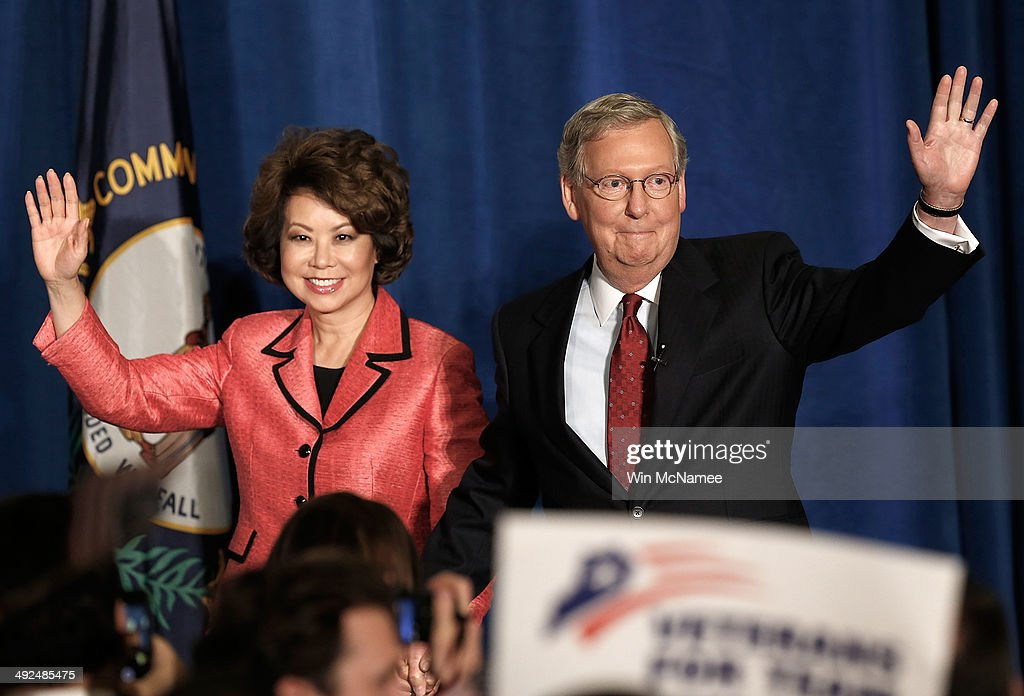 U.S. Senate Republican Leader Sen. <a gi-track='captionPersonalityLinkClicked' href=/galleries/search?phrase=Mitch+McConnell&family=editorial&specificpeople=217985 ng-click='$event.stopPropagation()'>Mitch McConnell</a> (R-KY) and his wife <a gi-track='captionPersonalityLinkClicked' href=/galleries/search?phrase=Elaine+Chao&family=editorial&specificpeople=568353 ng-click='$event.stopPropagation()'>Elaine Chao</a> arrive for a victory celebration following the early results of the state Republican primary May 20, 2014 in Louisville, Kentucky. McConnell defeated Tea Party challenger Matt Bevin in today's primary and will likely face a close race in the fall against Democratic candidate, Kentucky Secretary of State Alison Grimes.