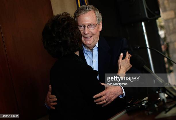 S Senate Republican Leader Sen Mitch McConnell is embraced by his wife Elaine Chao before speaking at a campaign rally May 19 2014 in Lexington...