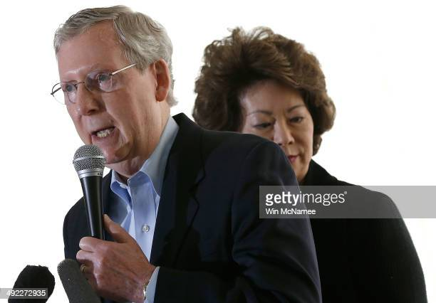 S Senate Republican Leader Sen Mitch McConnell speaks to supporters while campaigning at an early morning rally with his wife Elaine Chao May 19 2014...