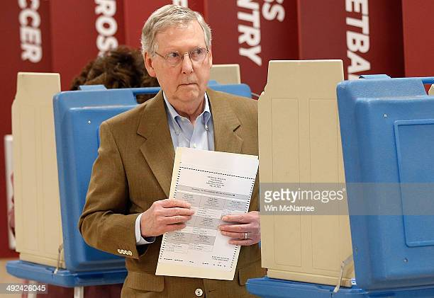 S Senate Republican Leader Sen Mitch McConnell votes in the state Republican primary at Bellarmine University May 20 2014 in Louisville Kentucky...