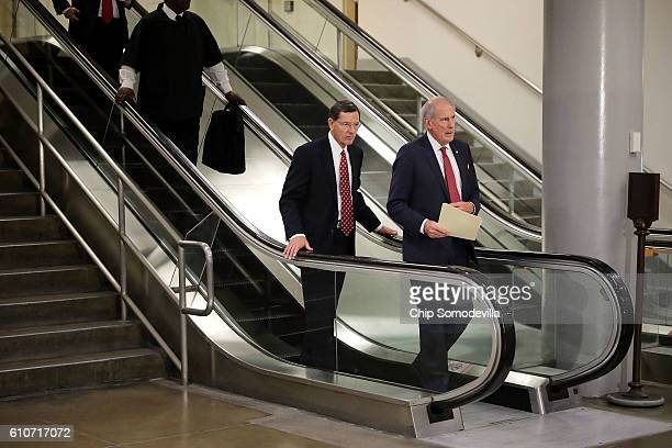 Senate Select Committee on Intelligence member Sen Dan Coats and Sen John Barrasso head for a classified briefing they and other members of the...