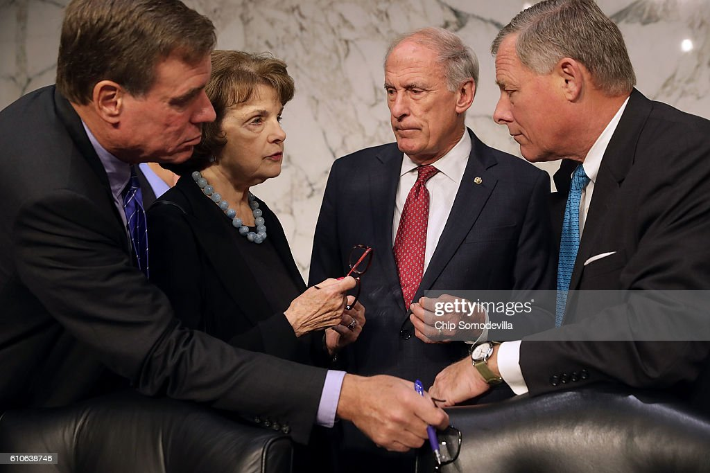 Senate Select Committee on Intelligence members (L-R) Sen. Mark Warner (D-VA), Sen. Dianne Feinstein (D-CA), Sen. Dan Coats (R-IN) and Chairman Richard Burr (R-NC) confer before hearing testimony from National Geospatial-Intelligence Agency Director Robert Cardillo in the Hart Senate Office Building on Capitol Hill September 27, 2016 in Washington, DC. This was the first time in the agency's 20 years that the director testified in an open hearing.