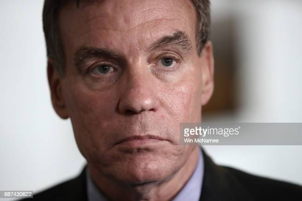 Senate Select Committee on Intelligence ranking member Mark Warner speaks to reporters after a meeting of the committee on Capitol Hill May 23 2017...