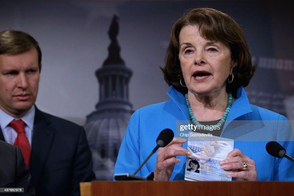 Senate Select Committee on Intelligence ranking member Sen. <a gi-track='captionPersonalityLinkClicked' href=/galleries/search?phrase=Dianne+Feinstein&family=editorial&specificpeople=214078 ng-click='$event.stopPropagation()'>Dianne Feinstein</a> (D-CA) (R) holds up her passport during a news conference about Democratic legislative proposals in the wake of last week's terror attacks in Paris with Sen. <a gi-track='captionPersonalityLinkClicked' href=/galleries/search?phrase=Chris+Murphy+-+Politico&family=editorial&specificpeople=12884903 ng-click='$event.stopPropagation()'>Chris Murphy</a> (D-CT) at the U.S. Capitol November 19, 2015 in Washington, DC. Senate Democrats proposed tightening the visa waiver program, requiring more biometric information and e-chip passports from overseas travelers visiting the United States and closing a loophole that allows people on the Terrorist Screening Center's No Fly List to purchase firearms or explosives. 'If you are too dangerous to board a plane then you are too dangerous to buy a gun,' said Feinstein.
