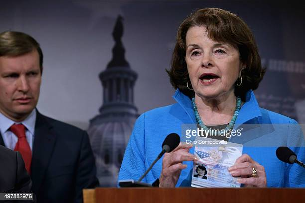 Senate Select Committee on Intelligence ranking member Sen Dianne Feinstein holds up her passport during a news conference about Democratic...