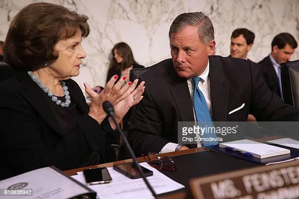 Senate Select Committee on Intelligence ranking member Sen Dianne Feinstein and Chairman Richard Burr confer before hearing testimony from National...