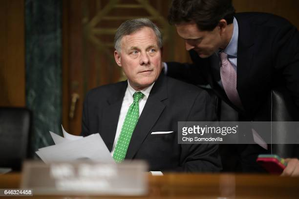 Senate Select Intelligence Committee Chairman Richard Burr listens to committee staff before former US Senator Dan Coats' confirmation hearing to be...
