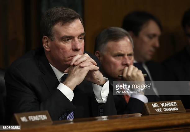 Senate Select Intelligence Committee Chairman Sen Richard Burr and ranking member Sen Mark Warner listen to testimony during a hearing of the Senate...