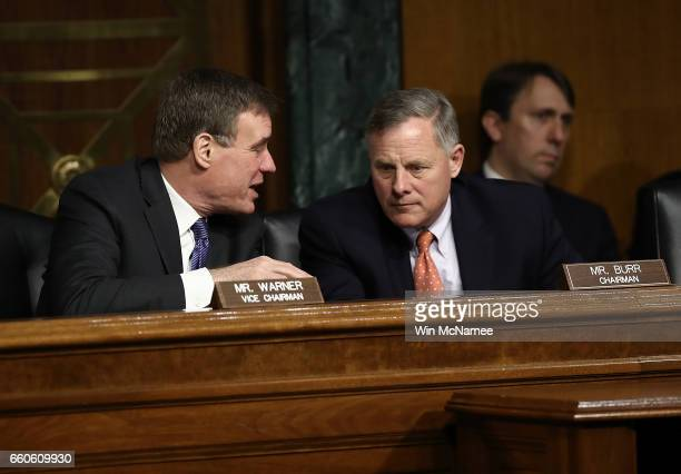 Senate Select Intelligence Committee Chairman Sen Richard Burr confers with ranking member Sen Mark Warner during a hearing of the Senate Select...