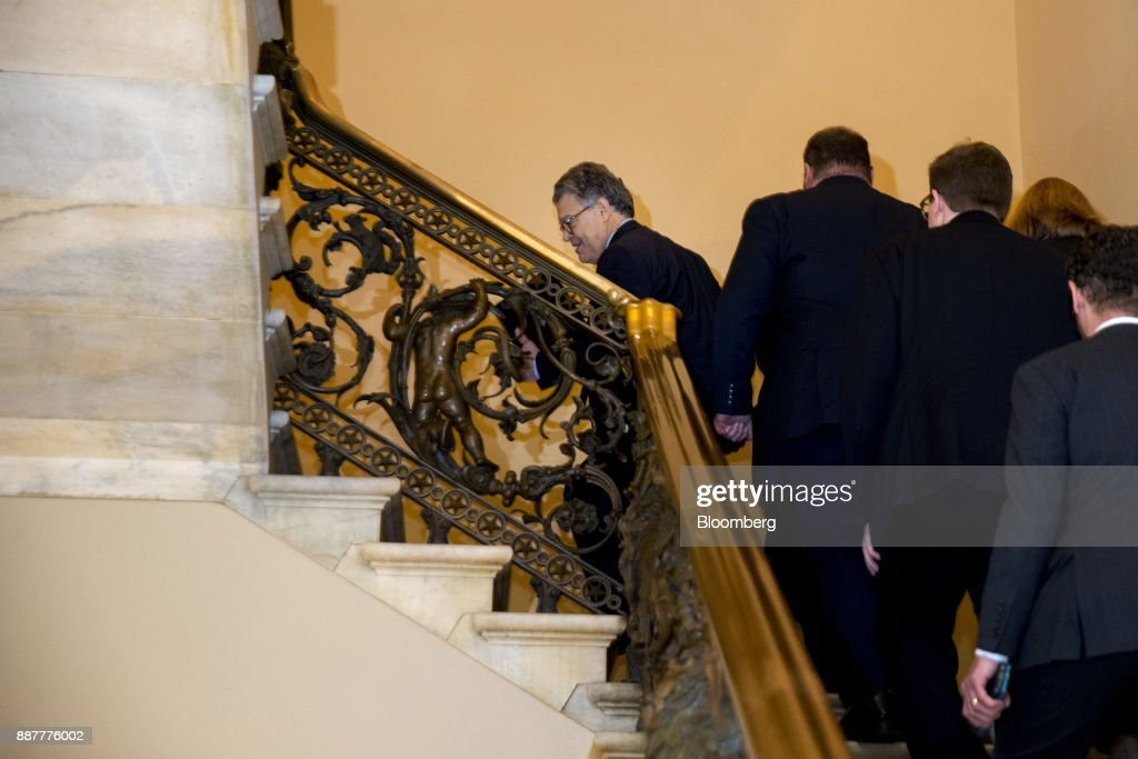 Senator Al Franken, a Democrat from Minnesota, center, walks through the U.S. Capitol before speaking on the Senate floor in Washington, D.C., U.S., on Thursday, Dec. 7, 2017. Frankenannounced Thursday hell resign to end the turmoil over allegations that he groped or tried to forcibly kiss several women after more than half of his Democratic colleagues demanded he step down to make clear that mistreatment of women is unacceptable. Photographer: Andrew Harrer/Bloomberg via Getty Images