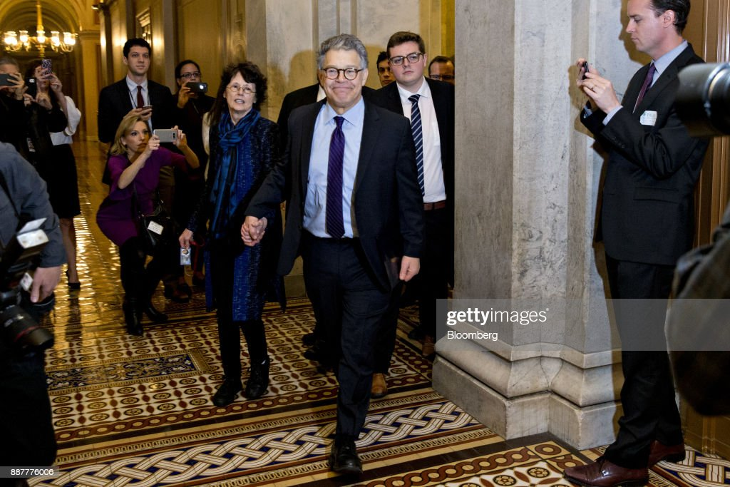 Senator Al Franken, a Democrat from Minnesota, walks through the U.S. Capitol with his wife Franni Bryson, center left, after speaking on the Senate floor in Washington, D.C., U.S., on Thursday, Dec. 7, 2017. Frankenannounced Thursday hell resign to end the turmoil over allegations that he groped or tried to forcibly kiss several women after more than half of his Democratic colleagues demanded he step down to make clear that mistreatment of women is unacceptable. Photographer: Andrew Harrer/Bloomberg via Getty Images