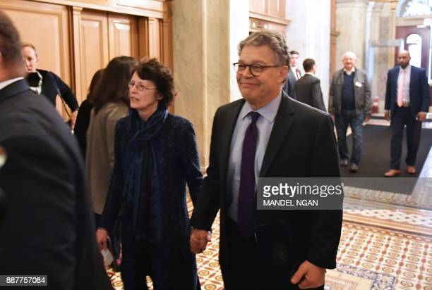 Senator Al Franken DMN and his wife Franni Bryson arrive at the US Capitol on December 7 2017 in Washington DC Franken announced that he will be...