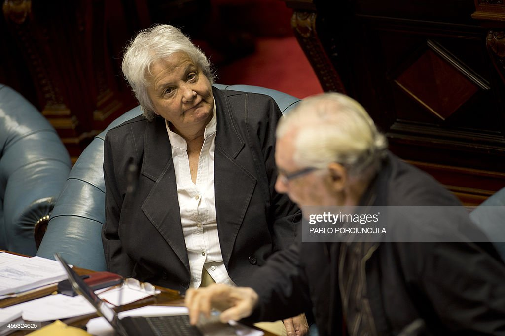 Senator and First Lady Lucia Topolansky of the ruling Frente Amplio (Broad Front) takes part in the parliament discussion of a law on the legalization of marijuana's cultivation and consumption on December 10, 2013, in Montevideo. Uruguays parliament is to vote Tuesday a project that would make the country the first to legalize marijuana, an experiment that seeks to confront drug trafficking. The initiative launched by 78-year-old Uruguayan President Jose Mujica, a former revolutionary leader, would enable the production, distribution and sale of cannabis, self-cultivation and consumer clubs, all under state control. AFP PHOTO/ Pablo PORCIUNCULA