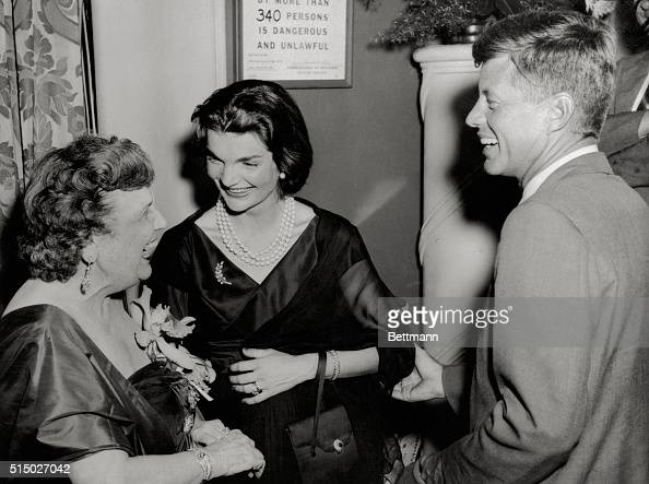 Senator and Mrs John Kennedy are greeted by 'The Hostess with the Mostest' Perle Mesta