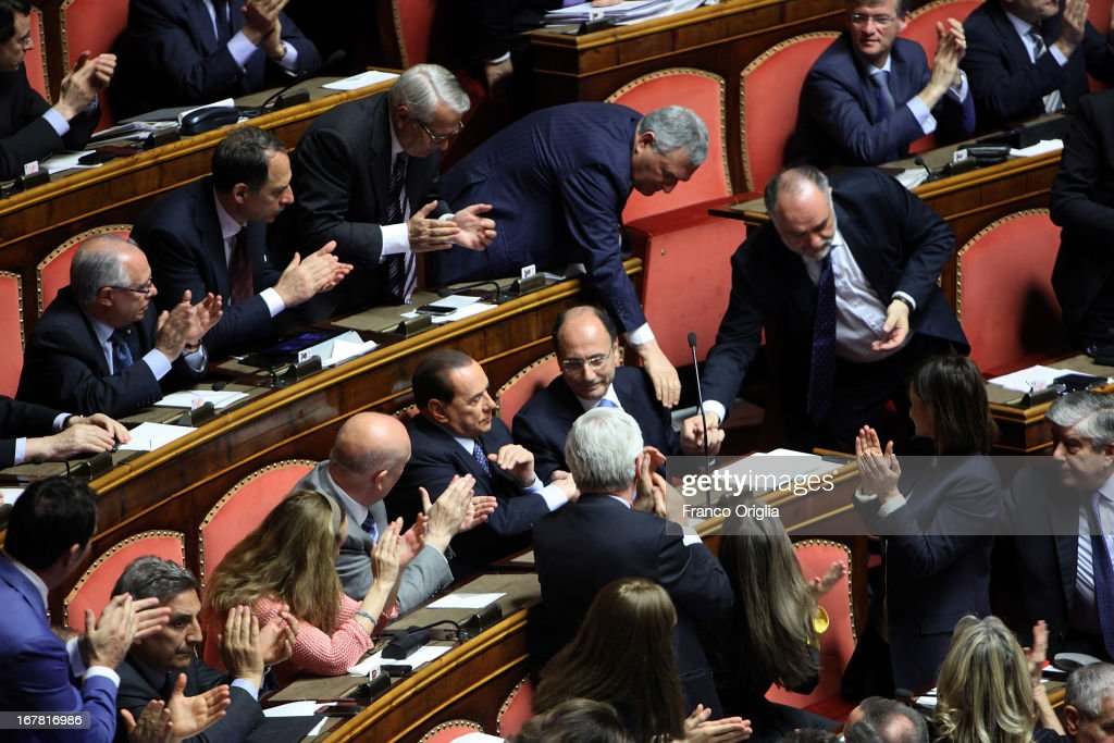 Senator applaud to <a gi-track='captionPersonalityLinkClicked' href=/galleries/search?phrase=Silvio+Berlusconi&family=editorial&specificpeople=201842 ng-click='$event.stopPropagation()'>Silvio Berlusconi</a> (C) during the confidence vote at the Senate on April 30, 2013 in Rome, Italy. The new coalition government was formed through extensive cooperation agreements between the right and left coalitions after a two-month long post-election deadlock.
